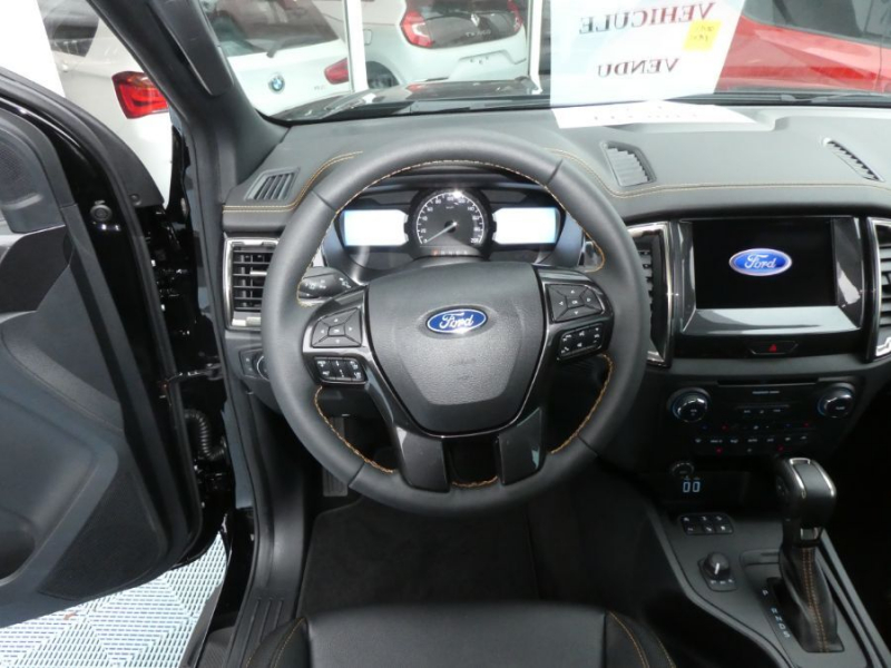 Photo 11 de l'offre de FORD RANGER SUPER CAB 2.0 TDCI 213 BVA10 4WD WILDTRAK Cover Pack Tech. à 39450€ chez Mérignac auto